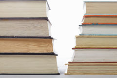 Serious books against fiction closeup Stock Photos
