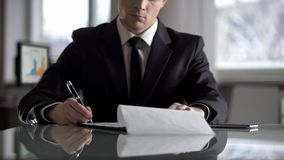 Serious boss signing agreement, important contract for company restructuring royalty free stock images