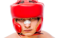 Serious boxers face in a red helmet. Isolated Royalty Free Stock Image