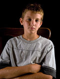 Serious boy. Portrait of handsome preteen boy looking serious, attentive, or bored Stock Images