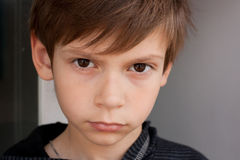Serious boy. Serious little boy looking at the camera Stock Photos