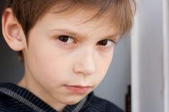Serious boy. Portrait of a serious little boy Stock Photos