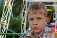 Serious boy. The serious boy of 6 years old on a big dipper Royalty Free Stock Photography