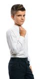 Serious boy adjusts his collar Royalty Free Stock Photo