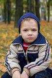 Serious boy in autumn Royalty Free Stock Photography