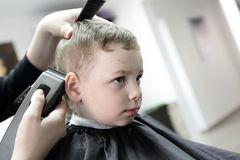 Serious boy at the barbershop Royalty Free Stock Photo
