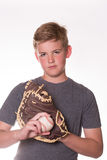 Serious Boy with baseball and glove. Boy looking serious while holding a baseball and glove stock image