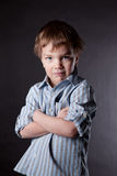 Serious boy on  black background. Royalty Free Stock Images