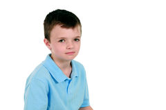 Serious boy in blue shirt Stock Images
