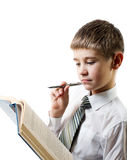 Serious boy and the book Stock Photography
