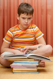 Serious boy with a books Royalty Free Stock Images