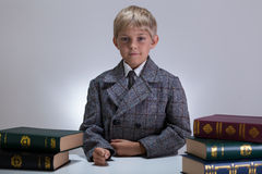 Serious boy among books Stock Image