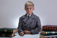 Serious boy among books Stock Image