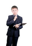 Serious boy in business suit Stock Images