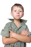 Serious boy with crossed hands Stock Image