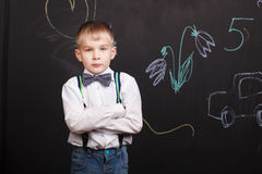 Serious boy crossed his arms, seriously and strictly looks Royalty Free Stock Images