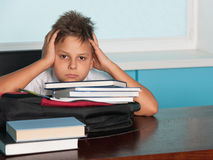 Serious boy at the desk Royalty Free Stock Photography