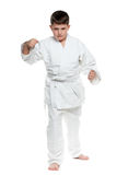 Serious boy in fighting stance. A portrait of a confident boy in fighting stance; on the white background royalty free stock photo