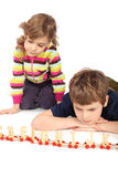 Serious boy and girl playing with wooden railway Stock Photography