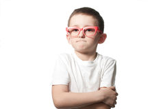 Serious boy in glasses. Isolated on the white background Stock Photos