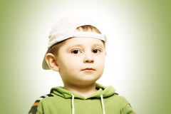 Serious boy in green Stock Image