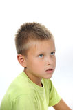 Serious boy with hair and gray eyes. Handsome serious boy with blond hair and gray eyes Stock Image
