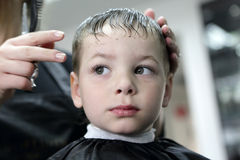 Serious boy at hairdresser salon Royalty Free Stock Photos