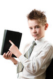 Serious boy points his finger at the book Stock Photo