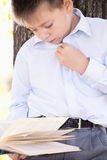 Serious boy reading book Stock Image