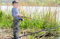 Serious Boy at the Riverside Holding Fishing Rod Stock Photos