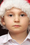 Serious boy in Santa cap Stock Photography