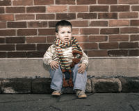 Serious boy sitting Royalty Free Stock Photography