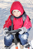 Serious boy on sledge Stock Image