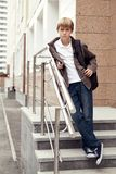 Serious boy standing on stairs. Outdoor Stock Photography