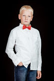 Serious boy stands with one hand in jean pocket Royalty Free Stock Images