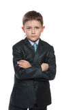 Serious boy in a suit with his hands crossed Stock Image