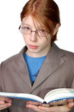 Serious boy wearing glasses with a book Stock Photography