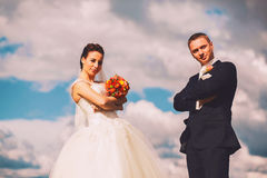 Serious bride and groom and sky Stock Photos