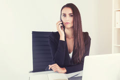 Serious brunette businesswoman on phone Royalty Free Stock Photo