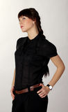 Serious brunette dressed in black Stock Photography