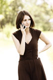Serious brunette listening phone Royalty Free Stock Photo