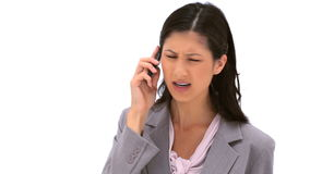 Serious brunette woman talking on her cellphone Stock Images