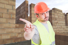 Serious builder doing a refusal gesture Stock Image