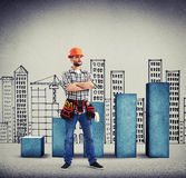 Serious builder with folded hands Stock Photos