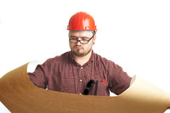 Serious builder in glasses and red hard hat Stock Images
