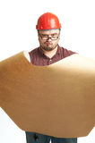 Serious builder in glasses and red hard hat Stock Photos