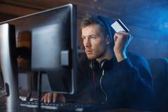 Serious burglar holding credit card stock photos