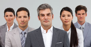 Serious busines people standing together Stock Image