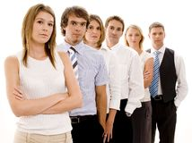 Serious Business. Six business people in a line looking serious (shallow depth of field Stock Photo