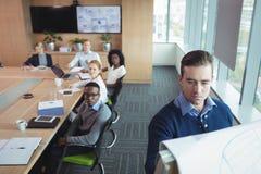 Serious business entrepreneur explaining strategy to team at office. Serious business entrepreneur explaining strategy to team in meeting room at office Stock Photo